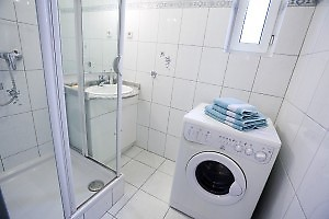 small window and washer in the bathroom