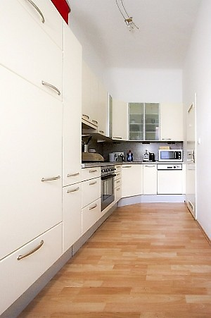 very long kitchen unit and great laminate floor
